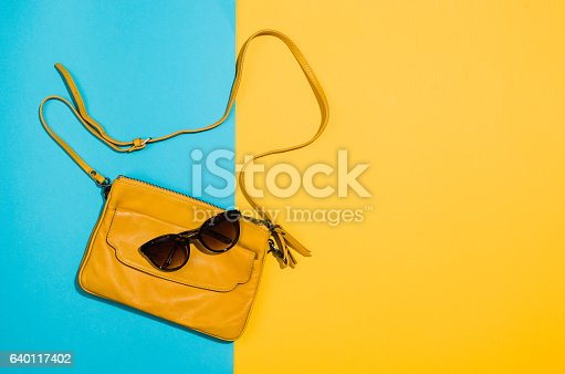 istock Woman's accessories flat lay on colorful background top view 640117402