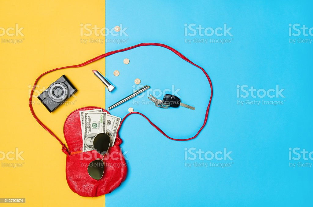 Woman's accessories lying flat on textured fabric background - foto de stock