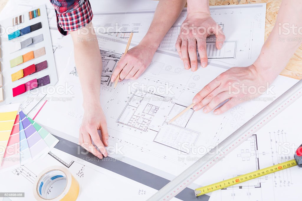 Woman's and man's hands with drafting tools stock photo