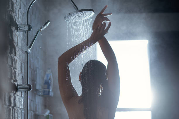 Woman's back Shower She felt relaxed and dancing. stock photo