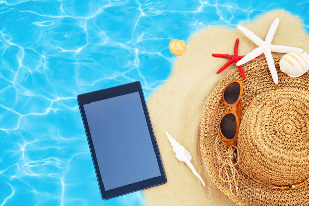 woman's beach accessories - phone, travelling, copy space imagens e fotografias de stock