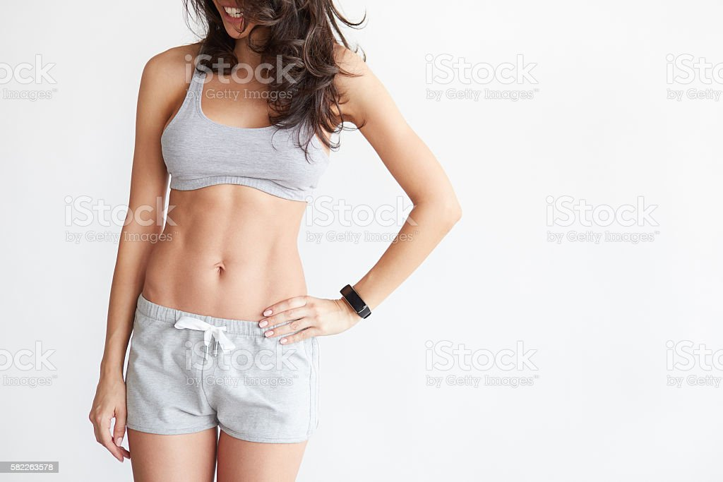 woman's body in sport wear on white stock photo