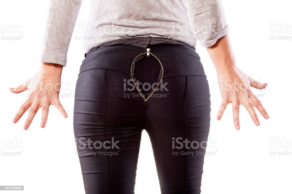 Woman's bottom with tight pants and opened zipper stock photo