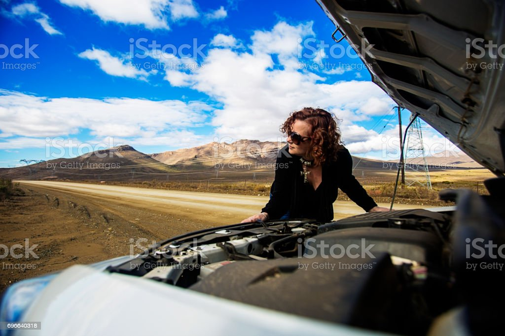 Womans car breaks down on country road stock photo