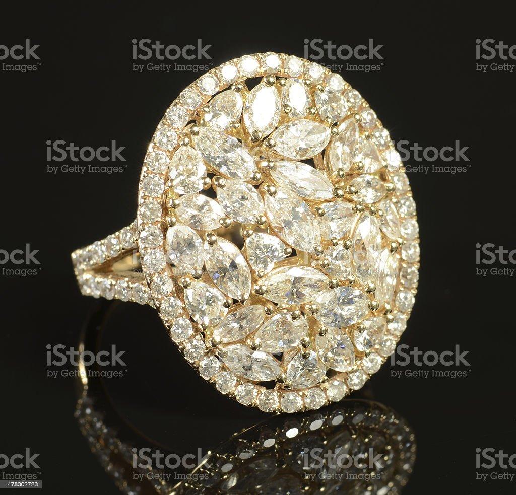 Woman's Diamond and Yellow Gold Wedding Ring royalty-free stock photo