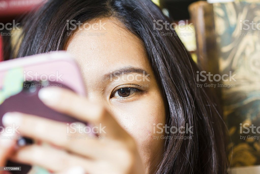 woman's eye a beautiful woman's eye staring at her smart phone Adult Stock Photo