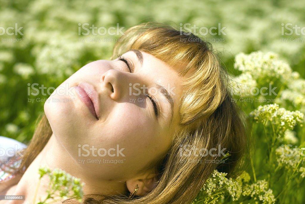 Woman's face enjoying the sun royalty-free stock photo