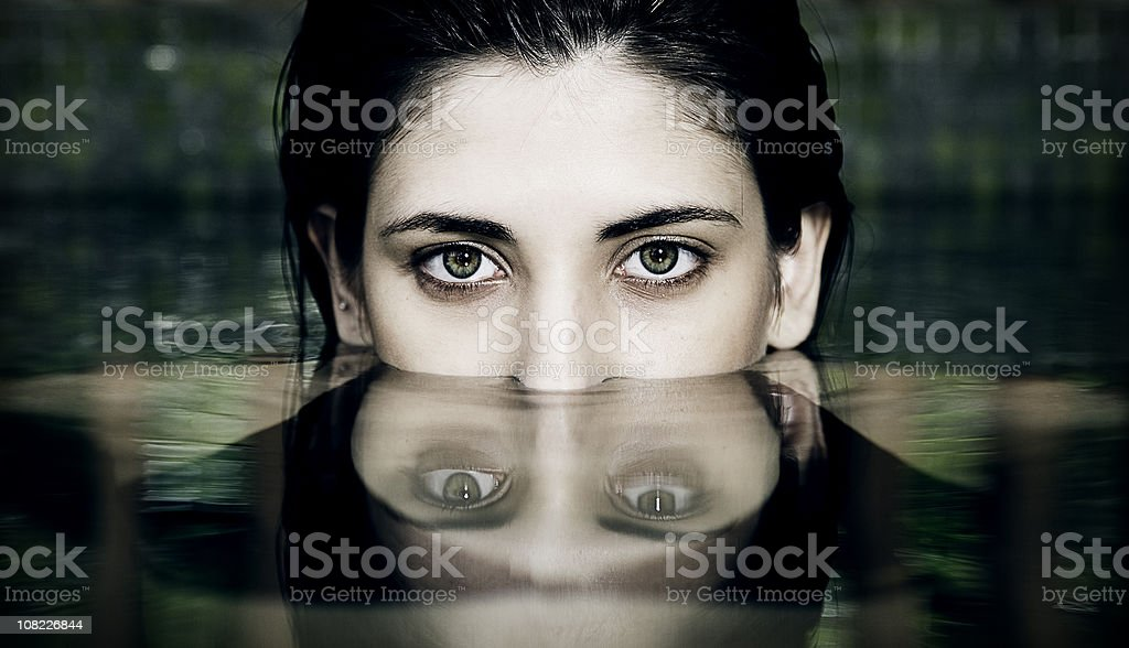 Woman's Face Half Submerged in Water stock photo