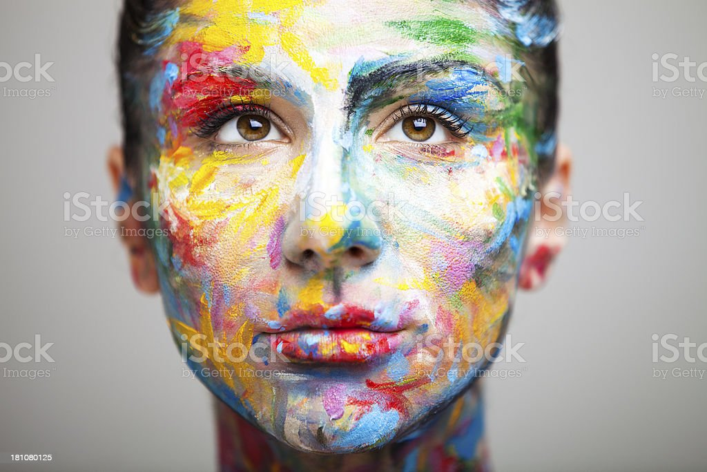 Womans Face Painted In Colorful Abstract Pattern Stock Photo
