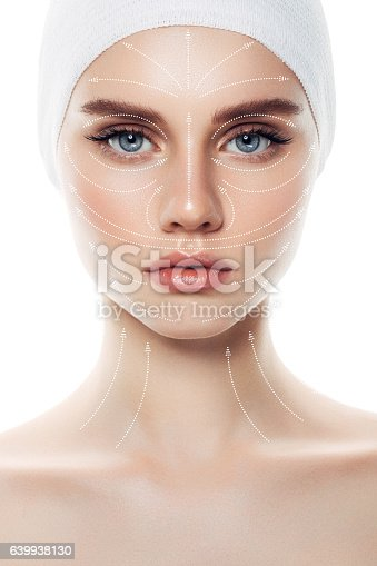 istock Woman's face with arrows as a model of facial massage 639938130