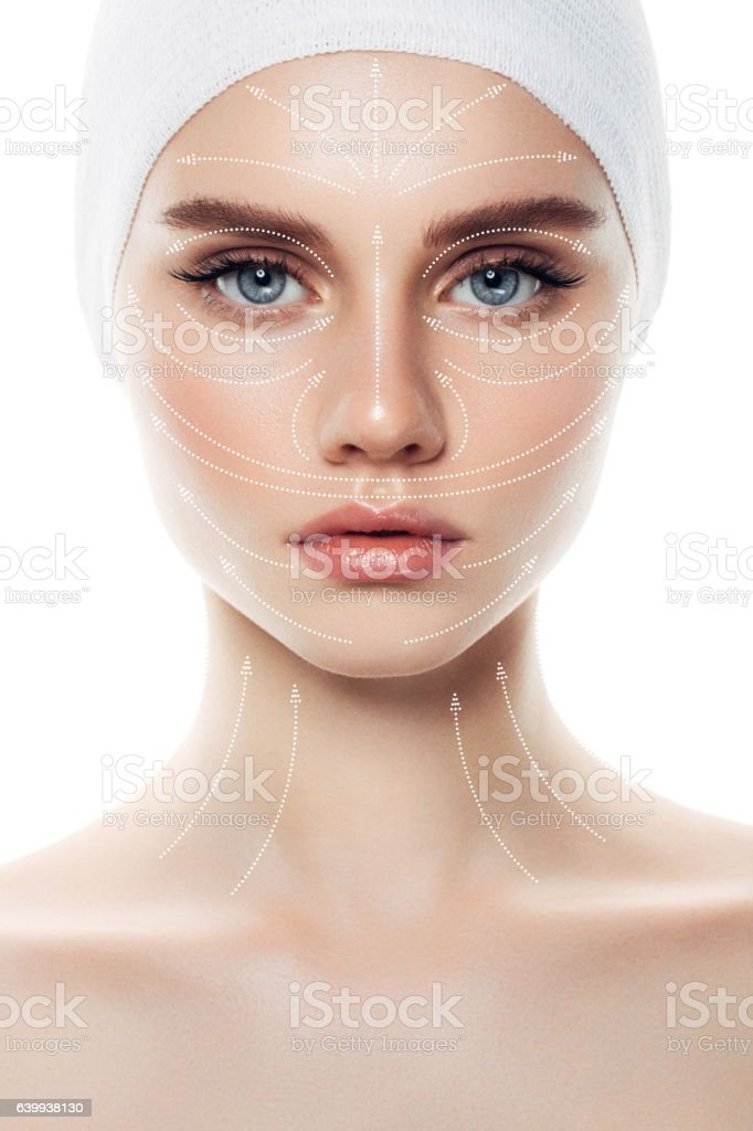 Woman's face with arrows as a model of facial massage stock photo