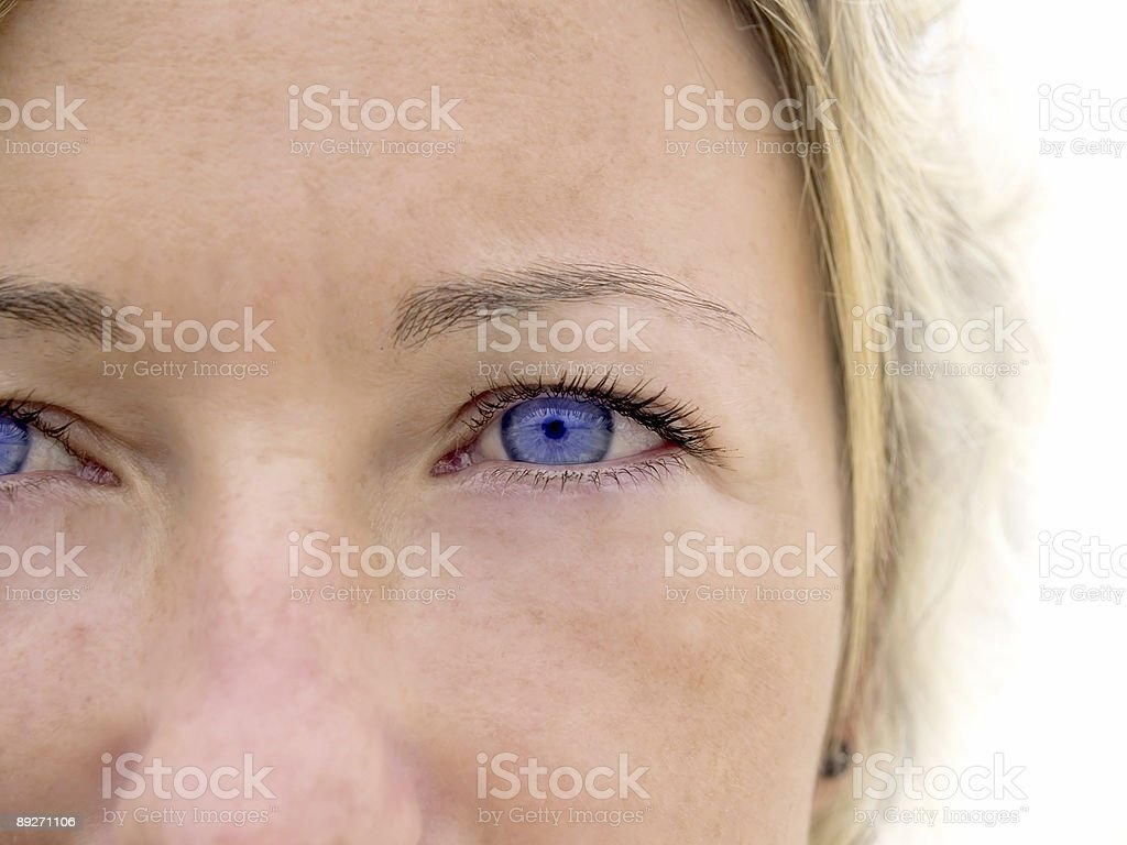 Woman's face with colorful blue eyes. royalty-free stock photo