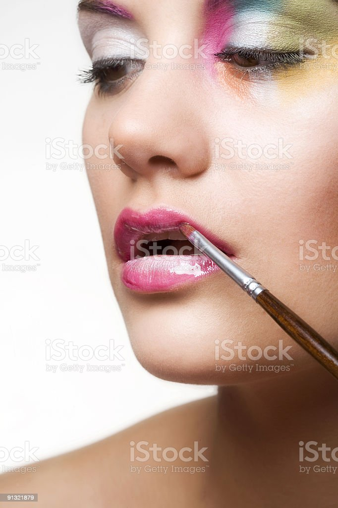 womans face with compact-disk make-up stock photo