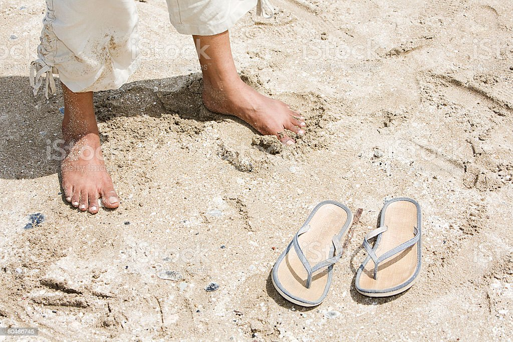 A womans feet on a beach royalty-free stock photo