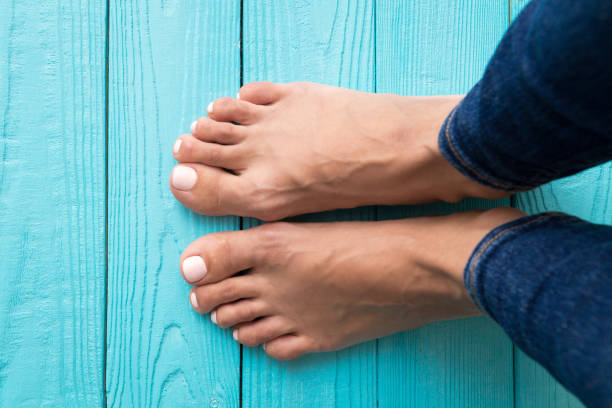 Woman's feet Woman's feet. Girl's feet on wooden floor view from above. foot stock pictures, royalty-free photos & images