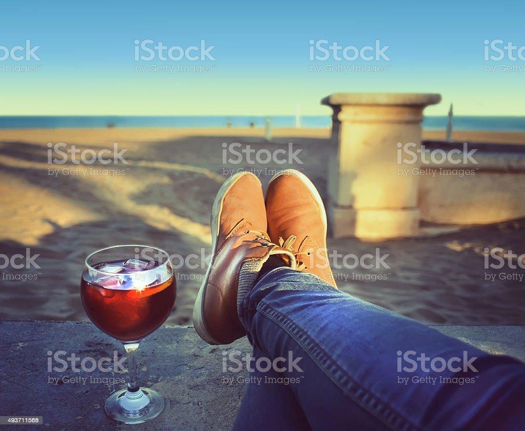 Woman's  Feet relaxing on the beach enjoying sun stock photo