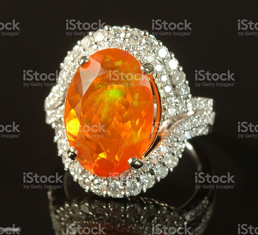 Woman's Fire Opal, Diamond and White Gold Ring royalty-free stock photo