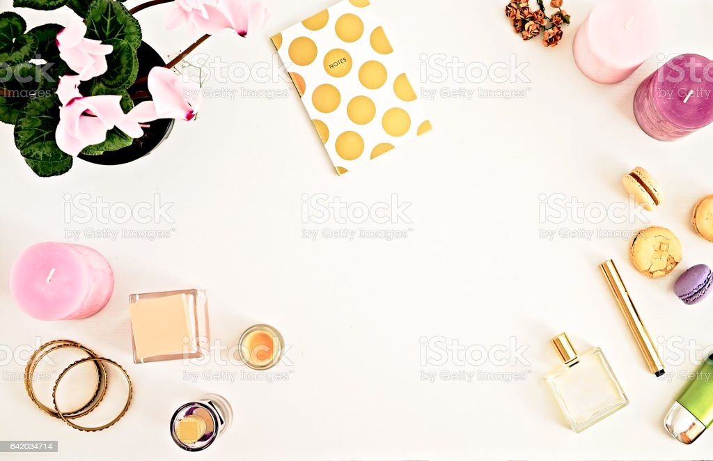 Woman's glamour make up products and accessories. Gold and white stock photo