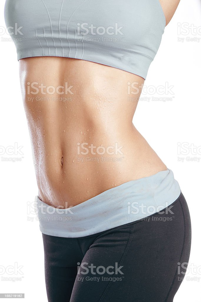 Woman's Glistening Abs stock photo