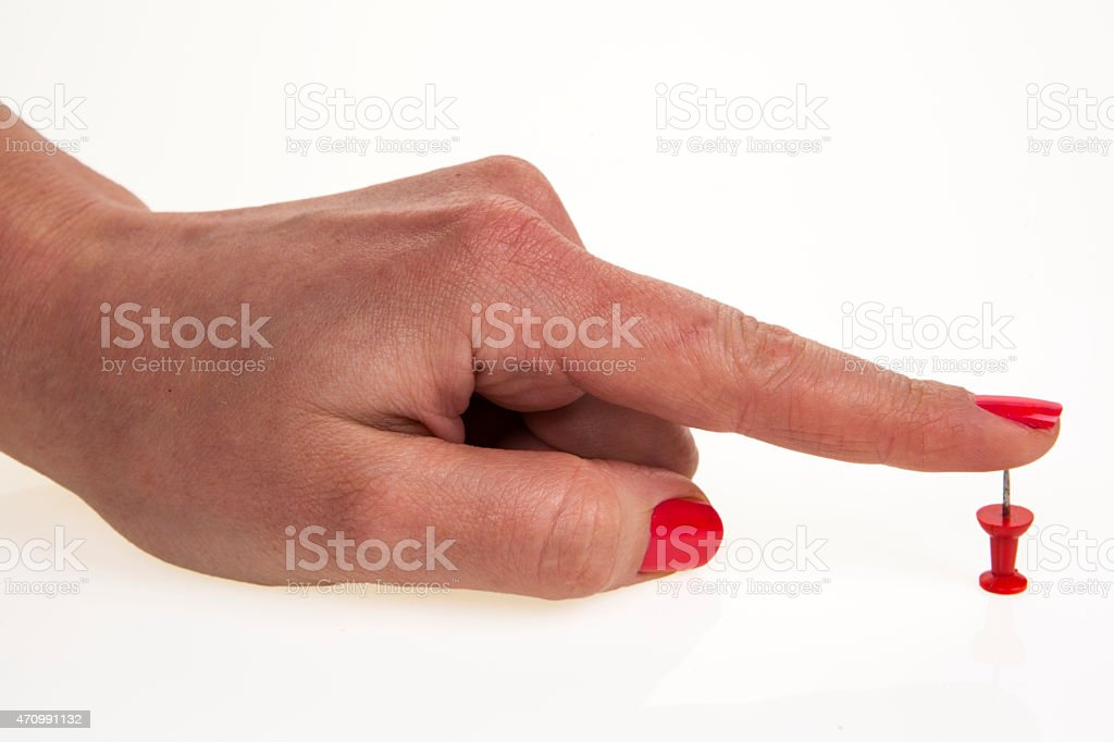 Woman's hand and pin stock photo