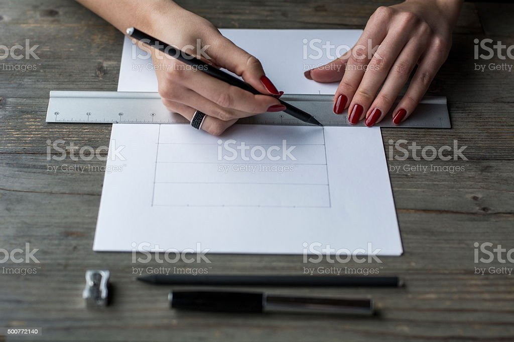 Woman's hand drawing with straightedge stock photo