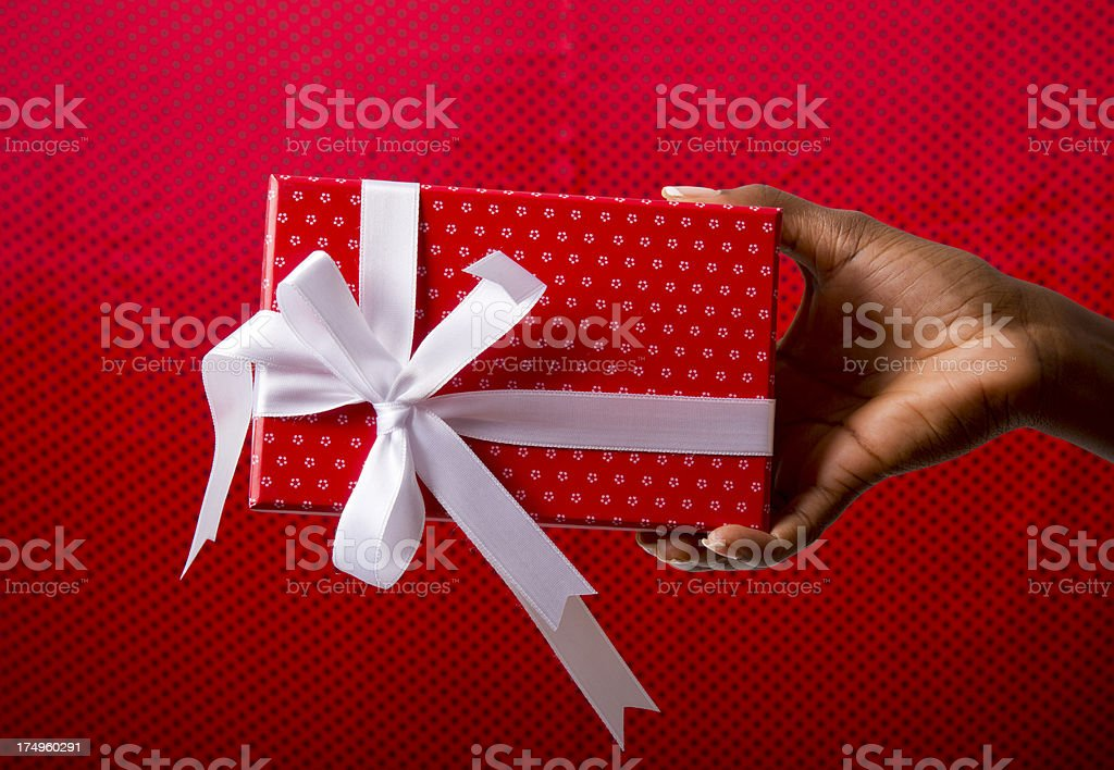 Woman's hand holding a red gift box royalty-free stock photo