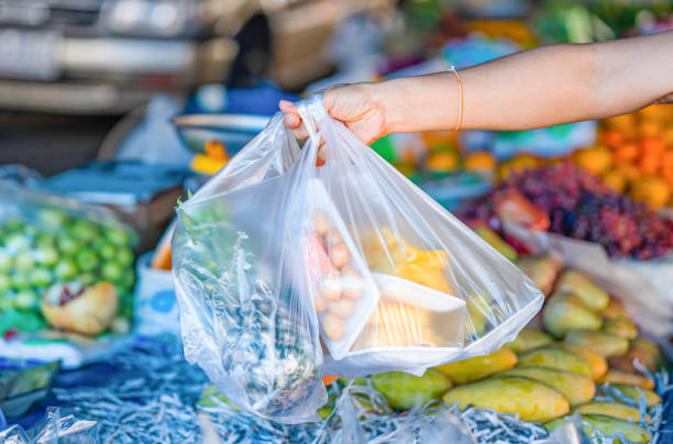 Woman's hand holding fruit bags Woman's hand holding fruit bags, plastic bags ,At the fruit shop market in asia stock pictures, royalty-free photos & images