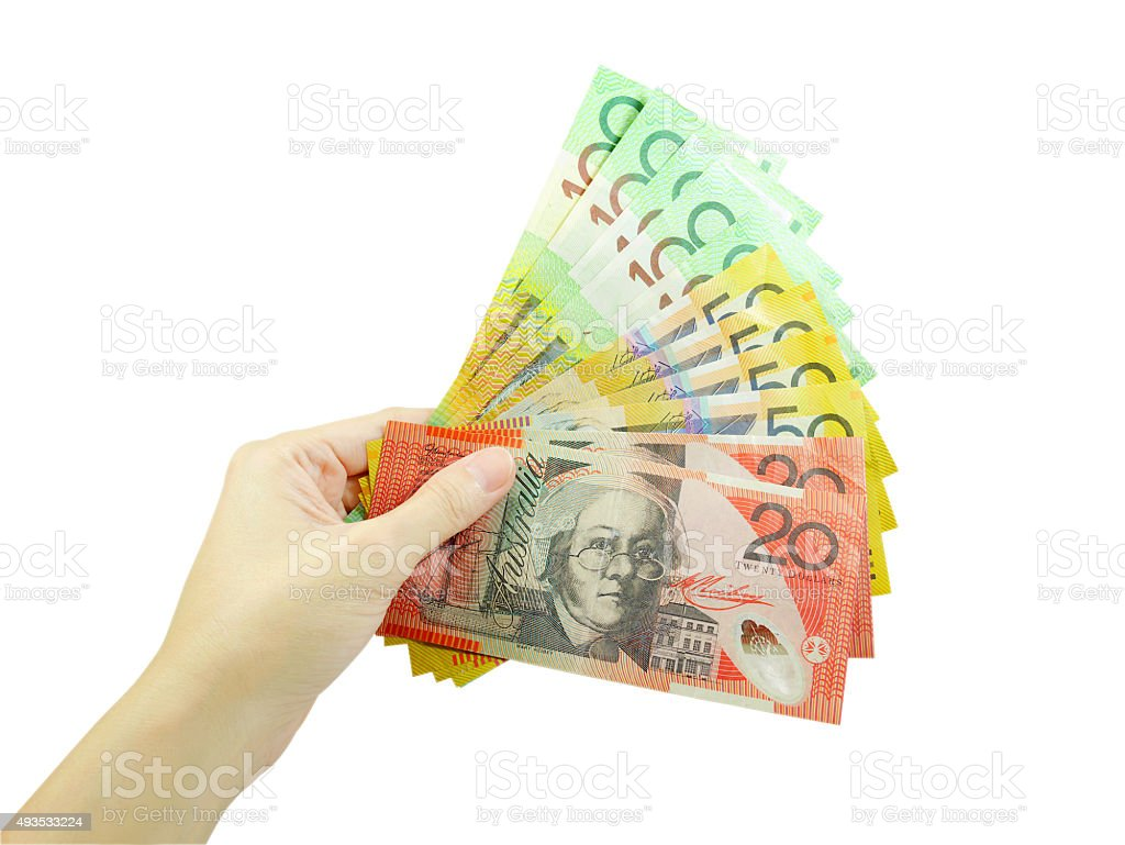 Woman's hand holding money stock photo
