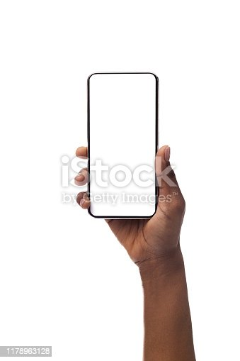 African american female hand holding smartphone with blank screen, isolated on white background. Copy space for advertisement of mobile app, mockup