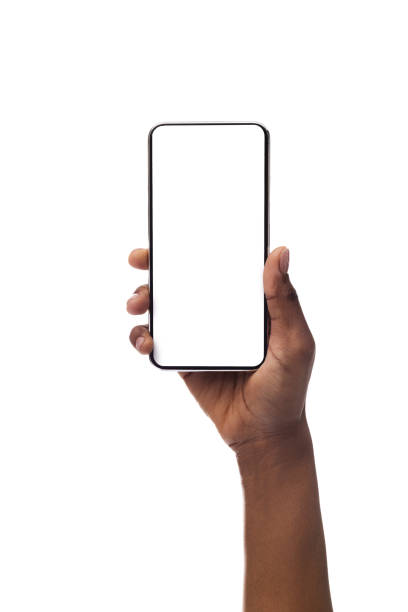 Woman's hand holding smartphone with blank screen, isolated on white background African american female hand holding smartphone with blank screen, isolated on white background. Copy space for advertisement of mobile app, mockup hand stock pictures, royalty-free photos & images