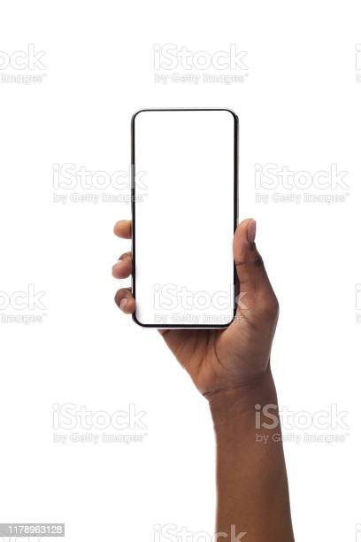 Photo of Woman's hand holding smartphone with blank screen, isolated on white background
