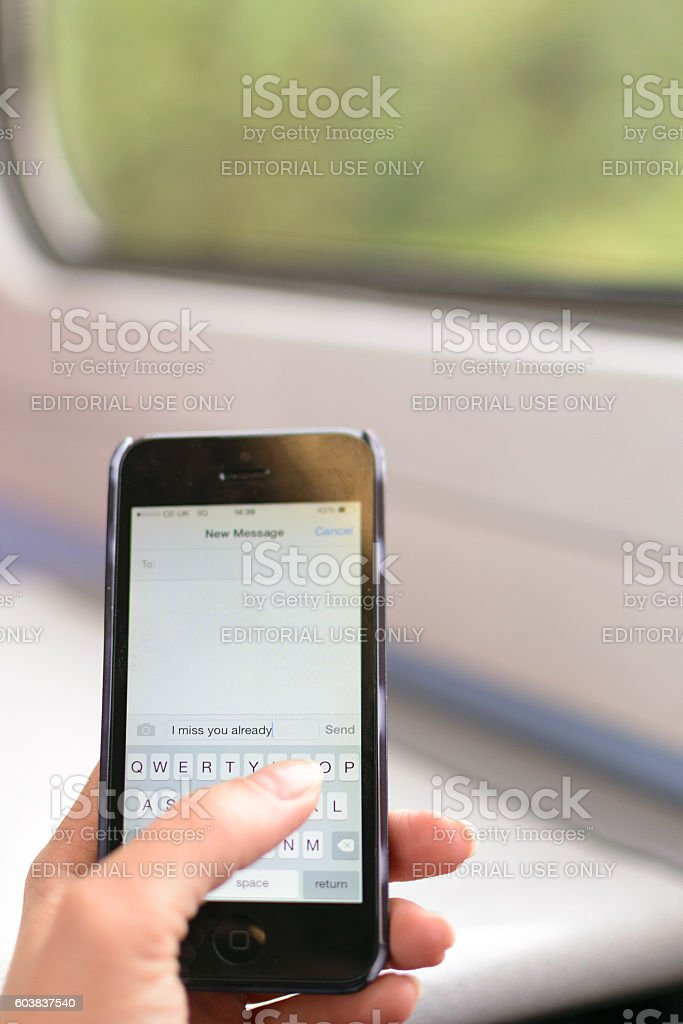 Woman's hand holds an Iphone 5 stock photo