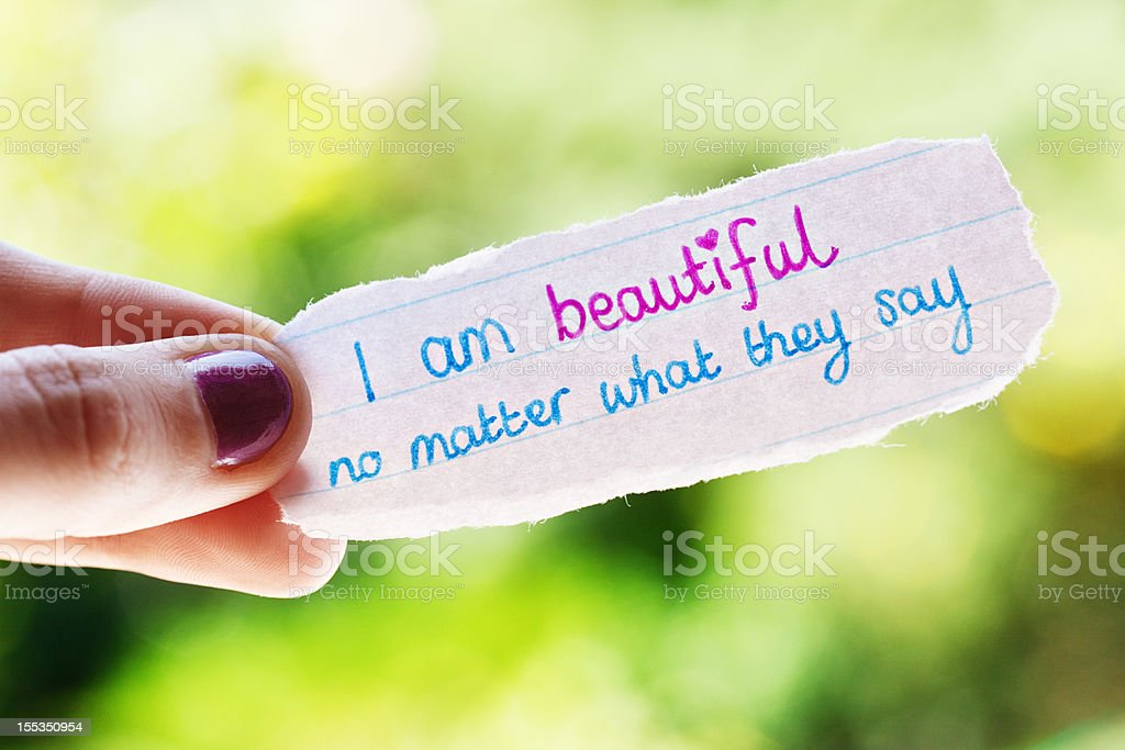 Woman's hand holds hand-drawn encouraging affirmation royalty-free stock photo