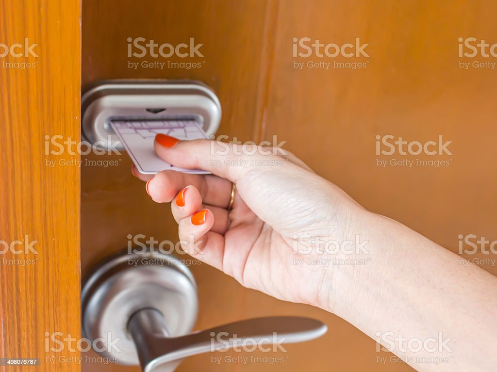 woman's hand inserting key card stock photo