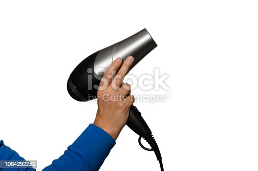 istock A woman's hand is holding a hair dryer 1064292252