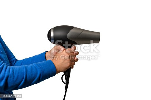 istock A woman's hand is holding a hair dryer 1064292280