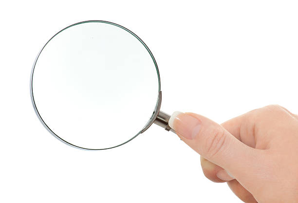 """womans hand is holding a lens isolated on white """"close up of magnifying glass, isolated on white"""" low scale magnification stock pictures, royalty-free photos & images"""