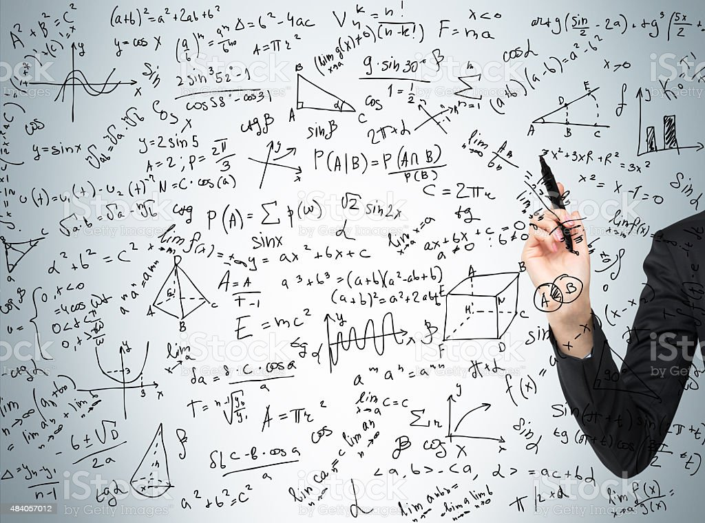 Woman's hand is pointing out the complicated math calculations stock photo