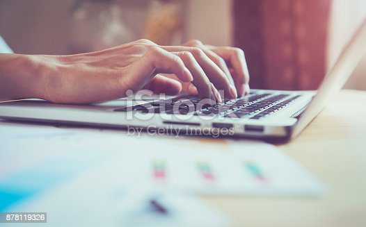 istock woman's hand is pressing a computer keyboard. It's a technology work. To make the work easier. Take your screen to put on advertising. 878119326