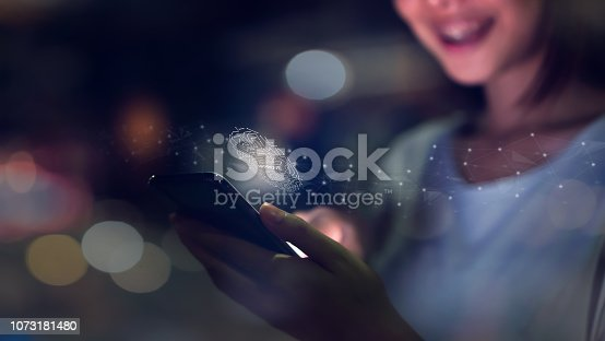 istock Woman's hand is scanning biometric fingerprint for approval to access smartphone. Concept of the danger of using electronic devices is important. 1073181480