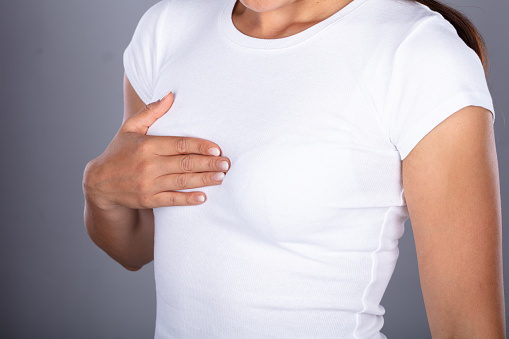 istock Woman's Hand On Breast 1037080320