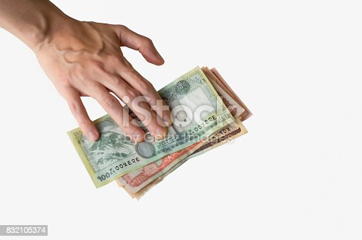 Woman's hand on Nepal Rupees banknotes