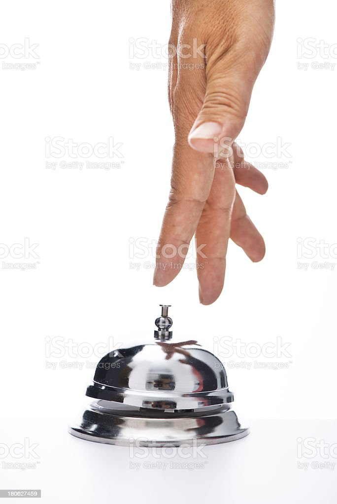 Woman's hand ringing hotel bell royalty-free stock photo