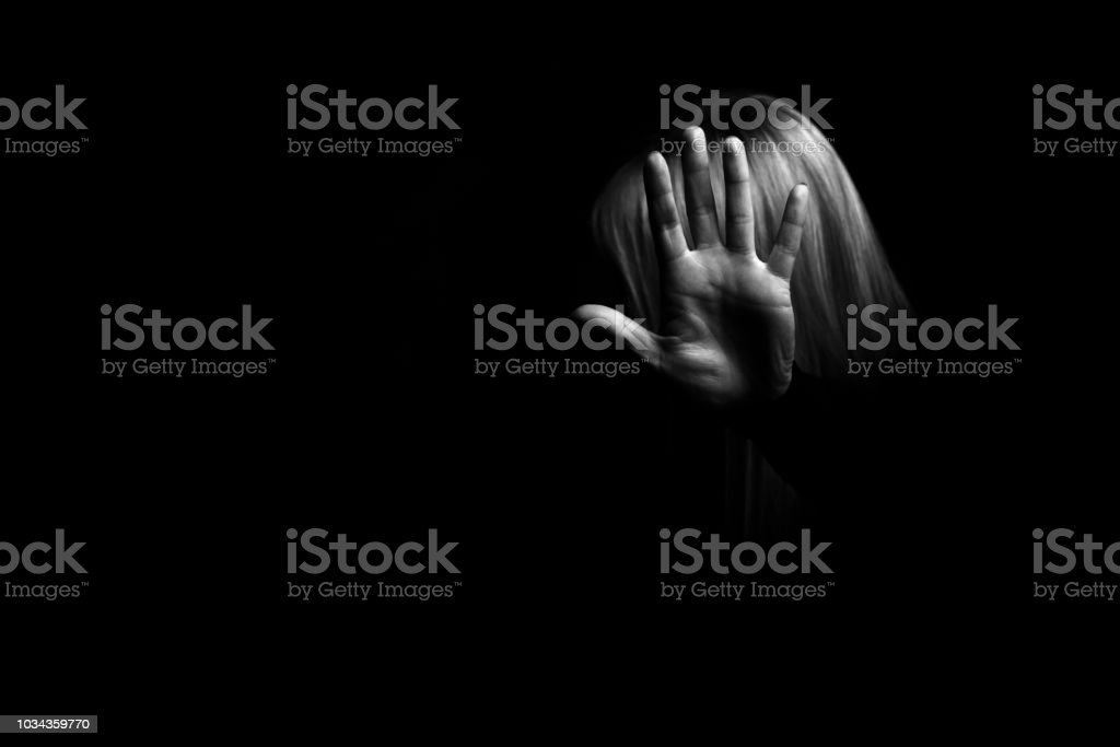 Woman's hand showing gesture STOP stock photo