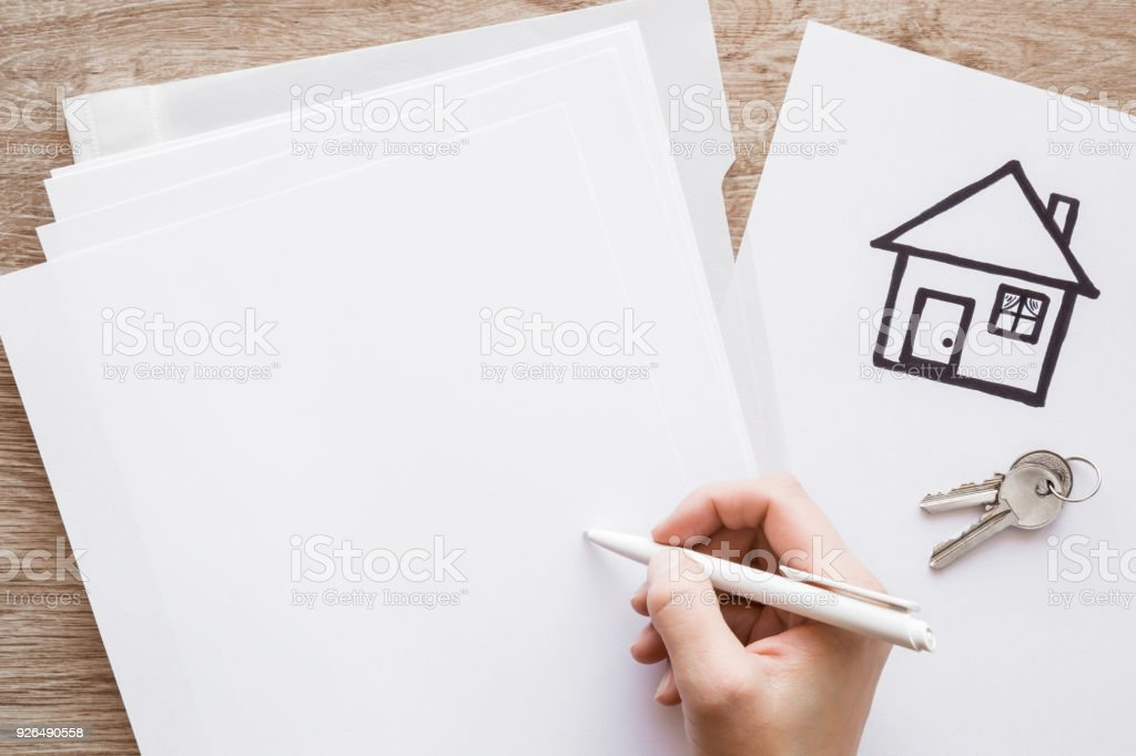 Womans Hand Signing An Agreement With Pen On An Office Desk