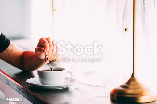 Woman's Hand Stirring Coffee