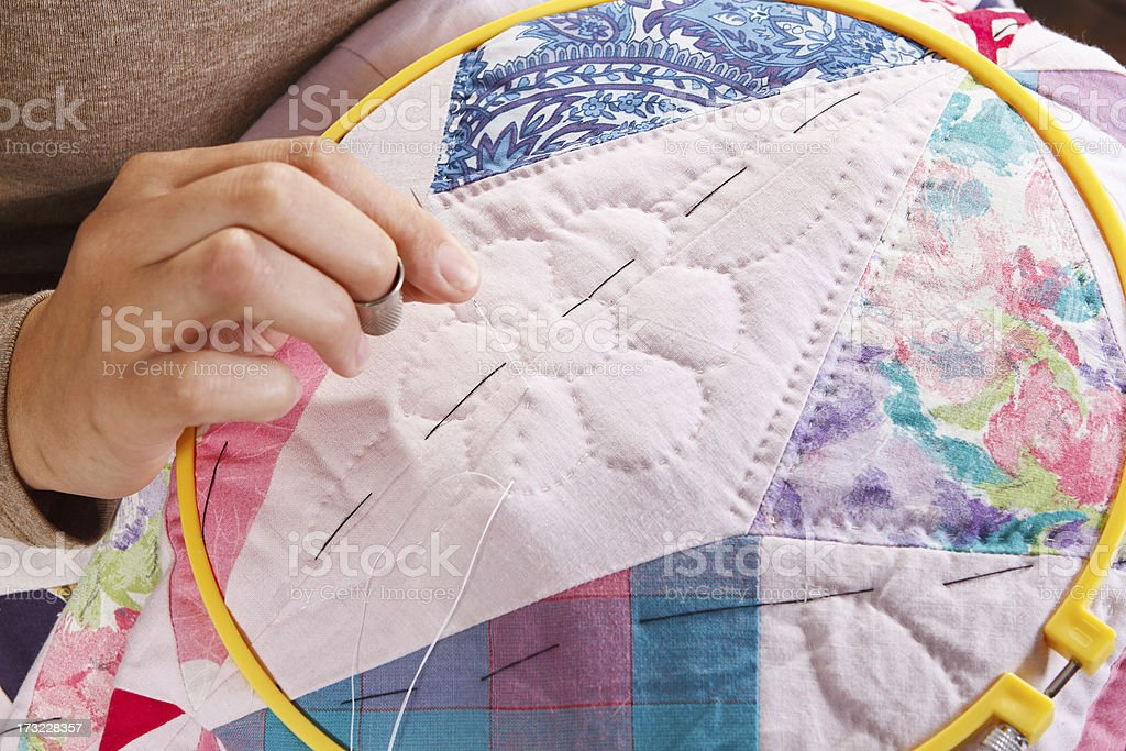 Woman's Hand Stitching A Patchwork Quilt royalty-free stock photo
