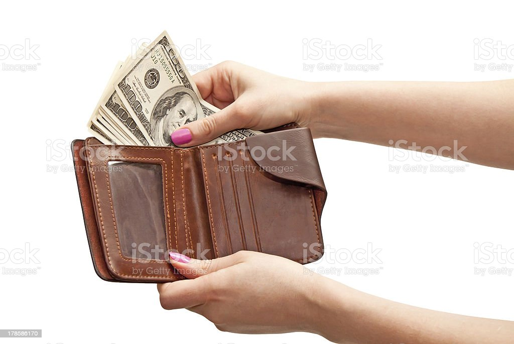 Woman's hand taking 100 dollars from the purse royalty-free stock photo