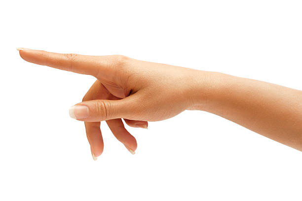 Woman's hand touching or pointing to something Woman's hand touching or pointing to something isolated on white background. Close up snapping stock pictures, royalty-free photos & images