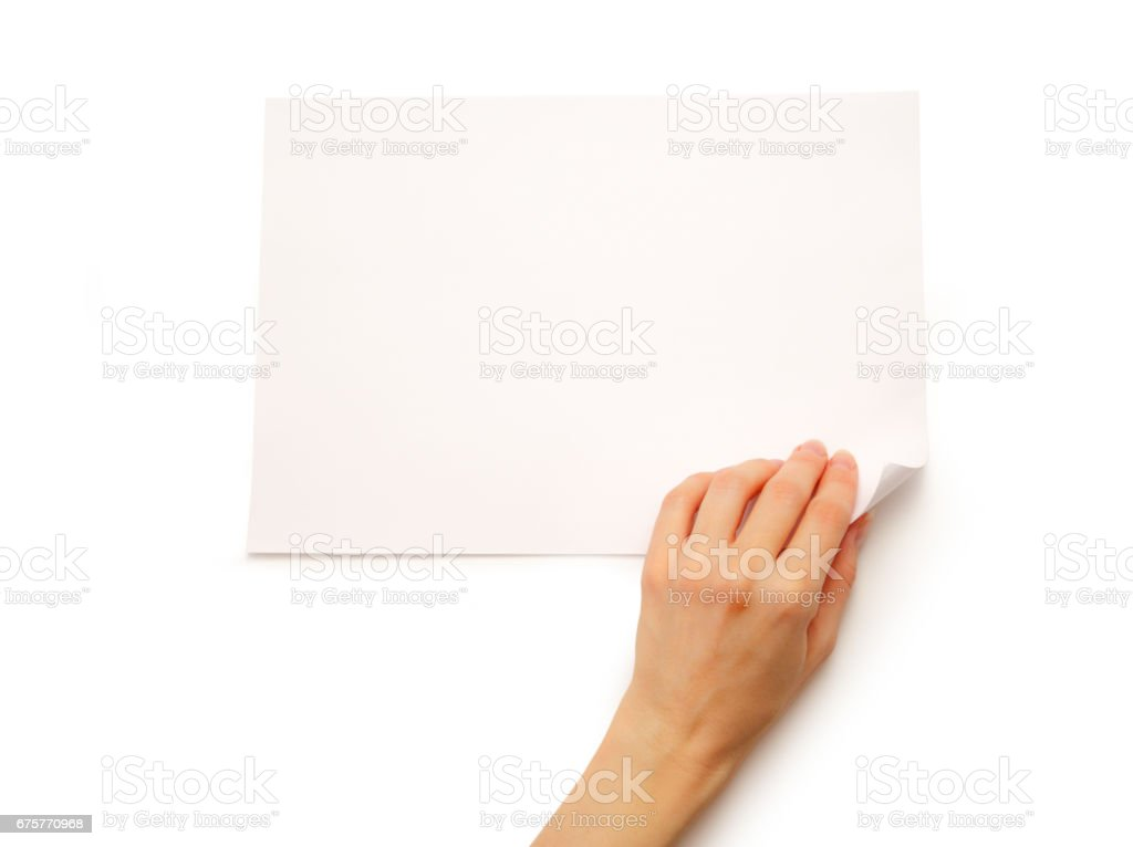 Woman's hand turning over paper stock photo